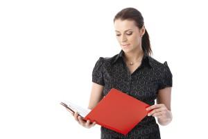 bigstock-Businesswoman-standing-reading-35457353 (2)